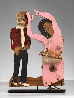 Woman in Pink Skirt and Standing Man