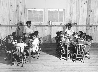 Hot lunches for children of agricultural workers in day nursery of Okeechobee, Migratory Labor camp. Belle Glade, Florida.