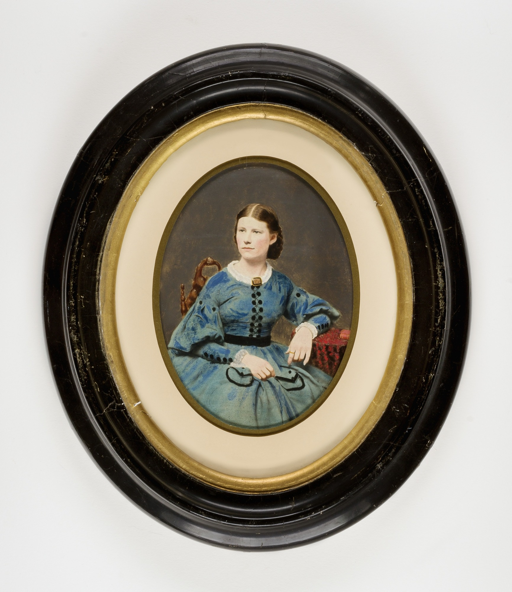 Seated Woman in Blue Dress with Black Trim