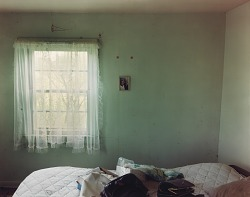 Bedroom in a house near Scranton, western North Dakota, June 9, 2000