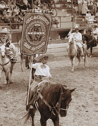 Young Charro with Banner