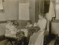 N.Y. tenement. Little ones helped in homework.