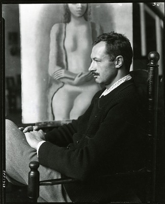 John Carroll seated in front of a painting [photograph] / (photographed by Peter A. Juley & Son)