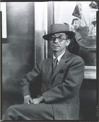 Yasuo Kuniyoshi seated in front of