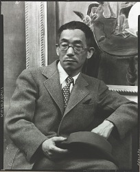 """Yasuo Kuniyoshi seated in front of """"Room 110"""" [photograph] / (photographed by Peter A. Juley & Son)"""