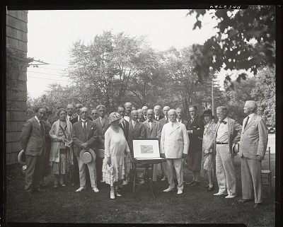 Lyme Art Association presenting a portfolio to Mr. & Mrs. William O. Goodman of Chicago [photograph] / (photographed by Peter A. Juley & Son)