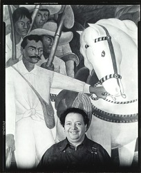 "Diego Rivera standing in front of ""Agrarian Leader Zapata,"" New York, 1931 [photograph] / (photographed by Peter A. Juley & Son)"