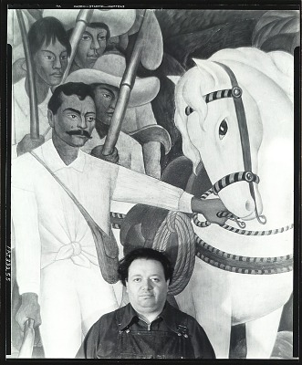 Diego Rivera standing in front of