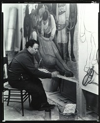 "Diego Rivera seated at work on ""Liberation of the Peon,"" New York [photograph] / (photographed by Peter A. Juley & Son)"