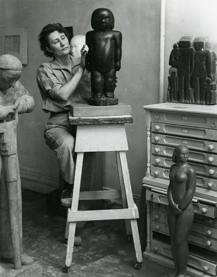 Unidentified female sculptor at work in studio [photograph] / (photographed by Peter A. Juley & Son)