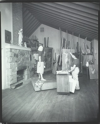Robert Brackman at work in his studio with model [photograph] / (photographed by Peter A. Juley & Son)