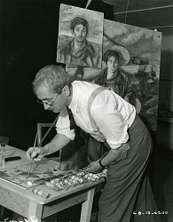 George Biddle at work in his studio [photograph] / (photographed by Peter A. Juley & Son)