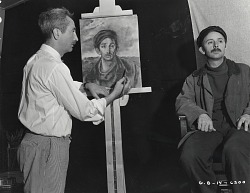 George Biddle in his studio with sitter John Qualen [photograph] / (photographed by Peter A. Juley & Son)