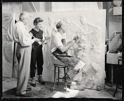Wilma Prezzi at work in her studio with two unidentified men [photograph] / (photographed by Peter A. Juley & Son)