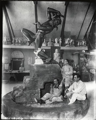 Frederic Victor Guinzburg in his studio with model for