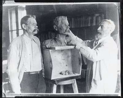Sergei Konenkov in his studio with sitter [photograph] / (photographed by Peter A. Juley & Son)