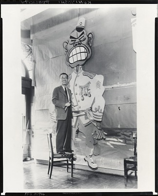 Yasuo Kuniyoshi at work on decorations for Art Students League Costume Ball, Roosevelt Hotel [photograph] / (photographed by Peter A. Juley & Son)