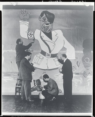 Faculty Members Jon Corbino, George Grosz, Yasou Kuniyoshi and Harry Sternberg at work on decorations for Art Students League Costume Ball, Roosevelt Hotel [photograph] / (photographed by Peter A. Juley & Son)