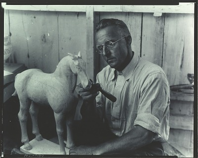Max Kuehne at work in his studio [photograph] / (photographed by Peter A. Juley & Son)