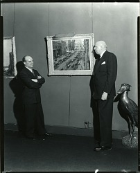 Alfred S. Mira (on left, with arms crossed) at the Grand Central Art Galleries with Associate Director Claude Barber (on right) [photograph] / (photographed by Peter A. Juley & Son)