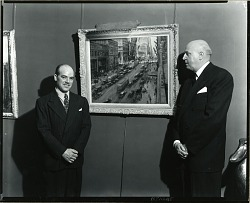 Alfred S. Mira (on left) at the Grand Central Art Galleries with Associate Director Claude Barber (on right) [photograph] / (photographed by Peter A. Juley & Son)