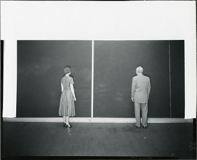 Barnett Newman and unidentified woman standing in front of