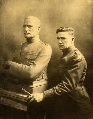 Robert Aitken standing next to model for