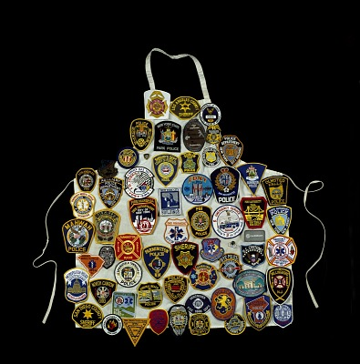 Badge-covered Apron