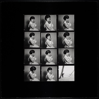 Enlarged Contact Sheet of Jacqueline Kennedy holding John, Jr.