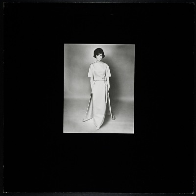 Photograph of Jacqueline Bouvier Kennedy wearing Oleg Cassini pre-inaugural ball gown