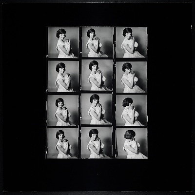 Enlarged Contact Sheet of Jacqueline Bouvier Kennedy holding John, Jr.