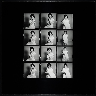 Enlarged contact sheet of Jacqueline Bouvier Kennedy holding John, Jr