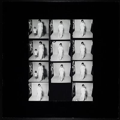 Enlarged Contact Sheet, Jacqueline Bouvier Kennedy wearing Oleg Cassini dress, three frames holding hands with Caroline