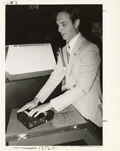 Image of James Gashel Uses Paperless Braille Reading Machine at NASM