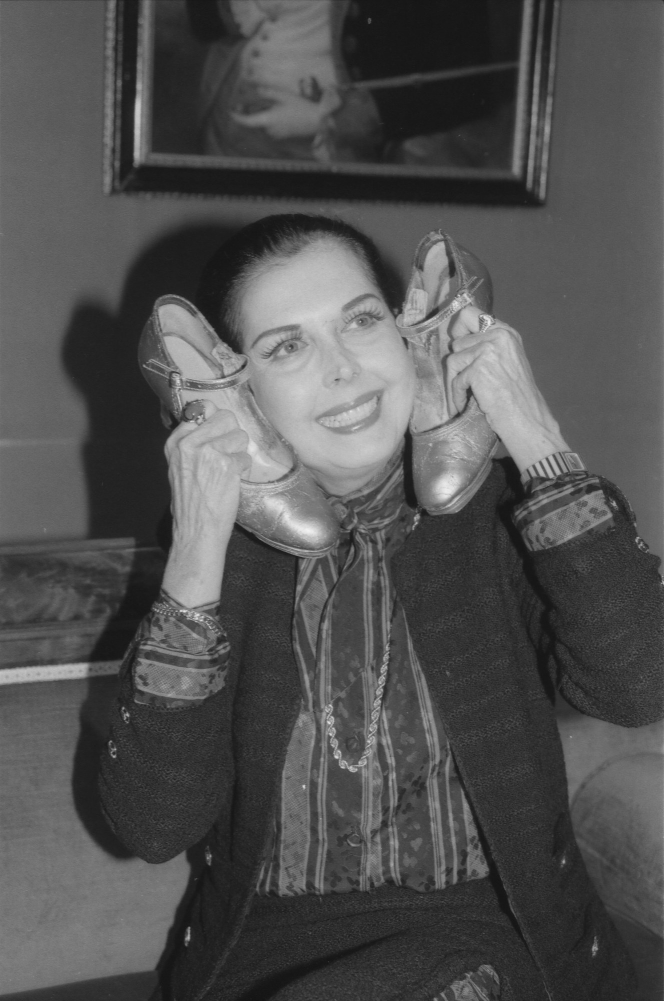 Ann Miller Posing with Her Shoes