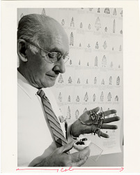 Portrait of National Museum of Natural History Archeologist Waldo Wedel with String of Beads