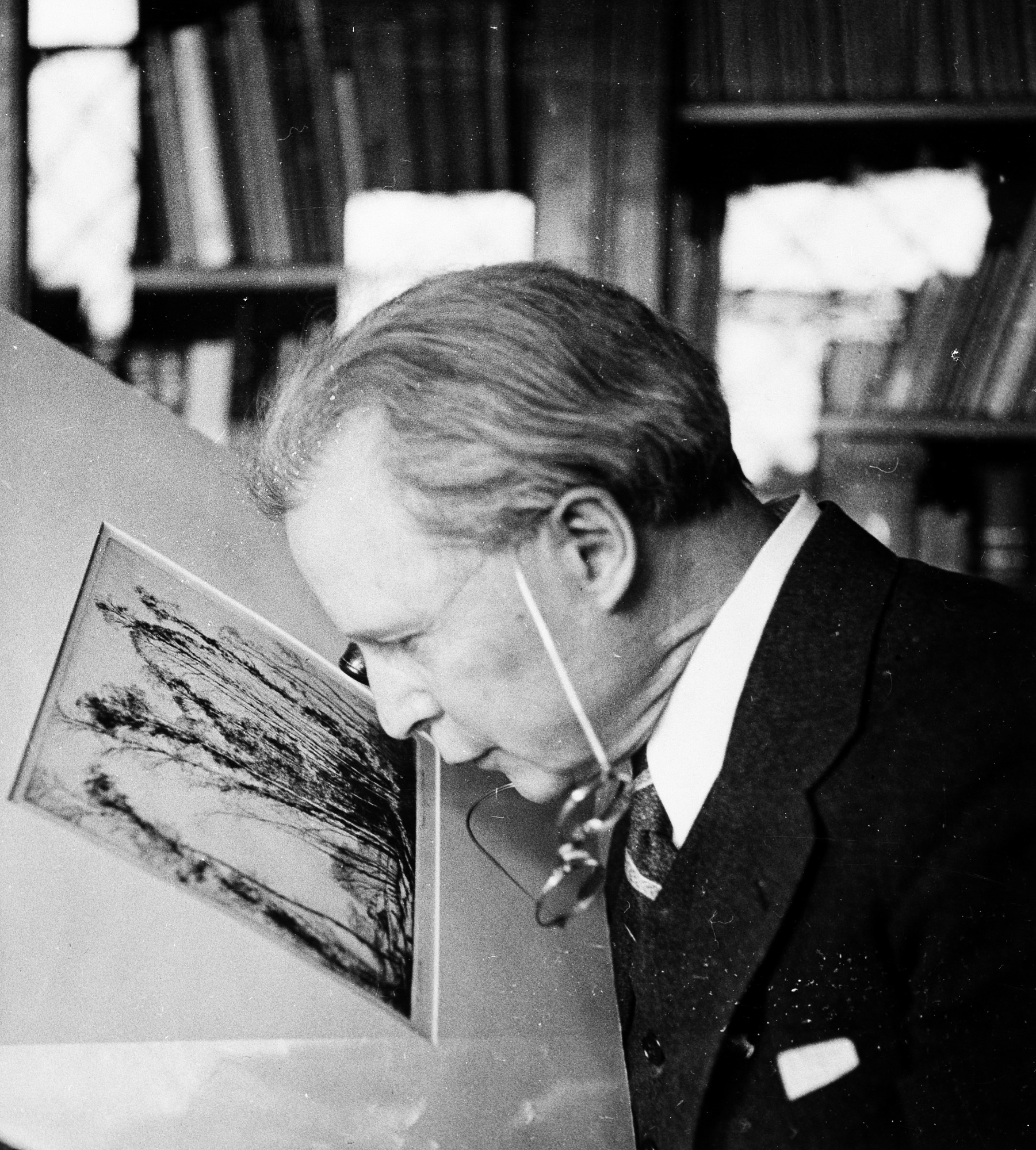 Ruel P. Tolman Examining Art Work, by Unknown, c. 1935, Smithsonian Archives - History Div, 96-556.