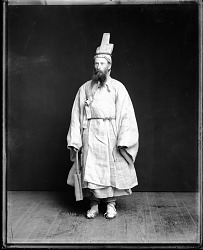 Lt. T. Dix Bolles Models Korean Mourning Costume