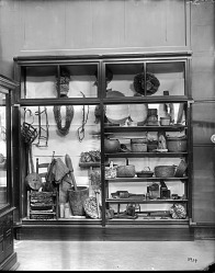 Exhibit Case of Domestic Artifacts from Colonial Life in America