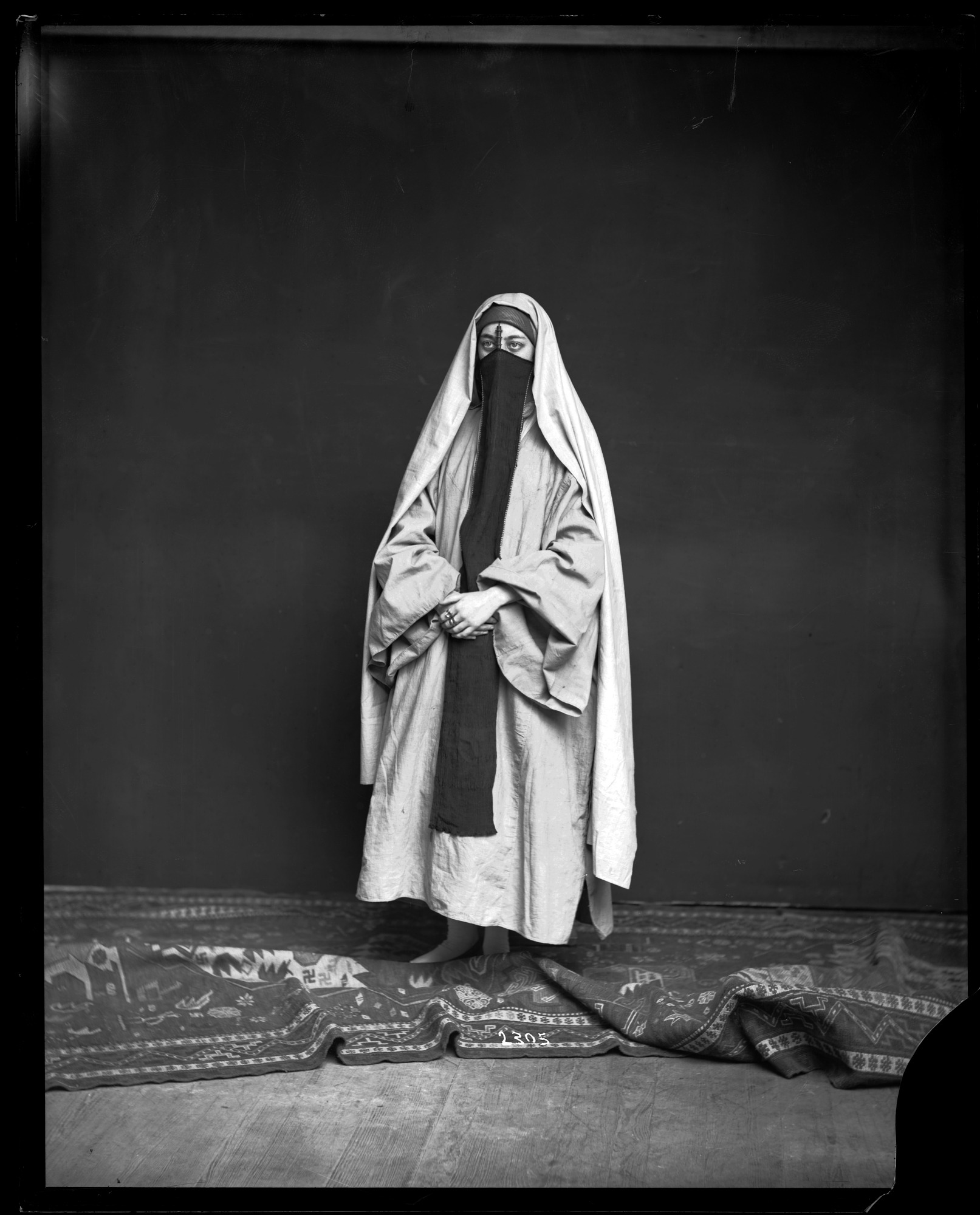 Unidentified Female Models Traditional Middle Eastern Costume with Yashmak (Veil)