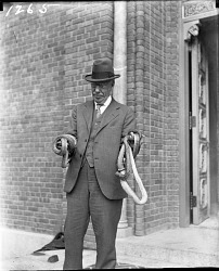 W.H. Blackburne with Snakes Outside Reptile House