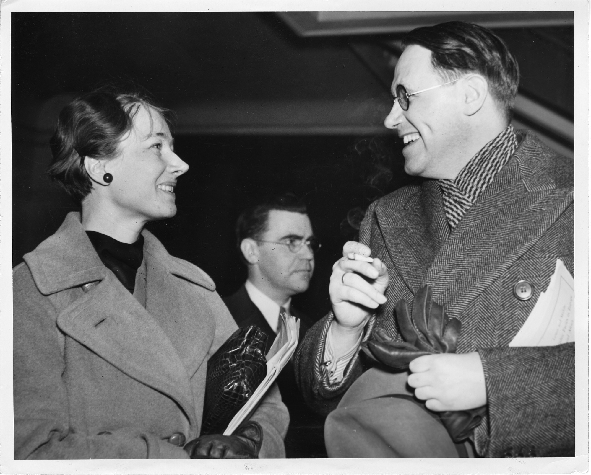 Frederica Annis Lopez de Leo de Laguna (1906-2004), standing and talking at meeting with Kaj Birket-Smith (1893-1977)