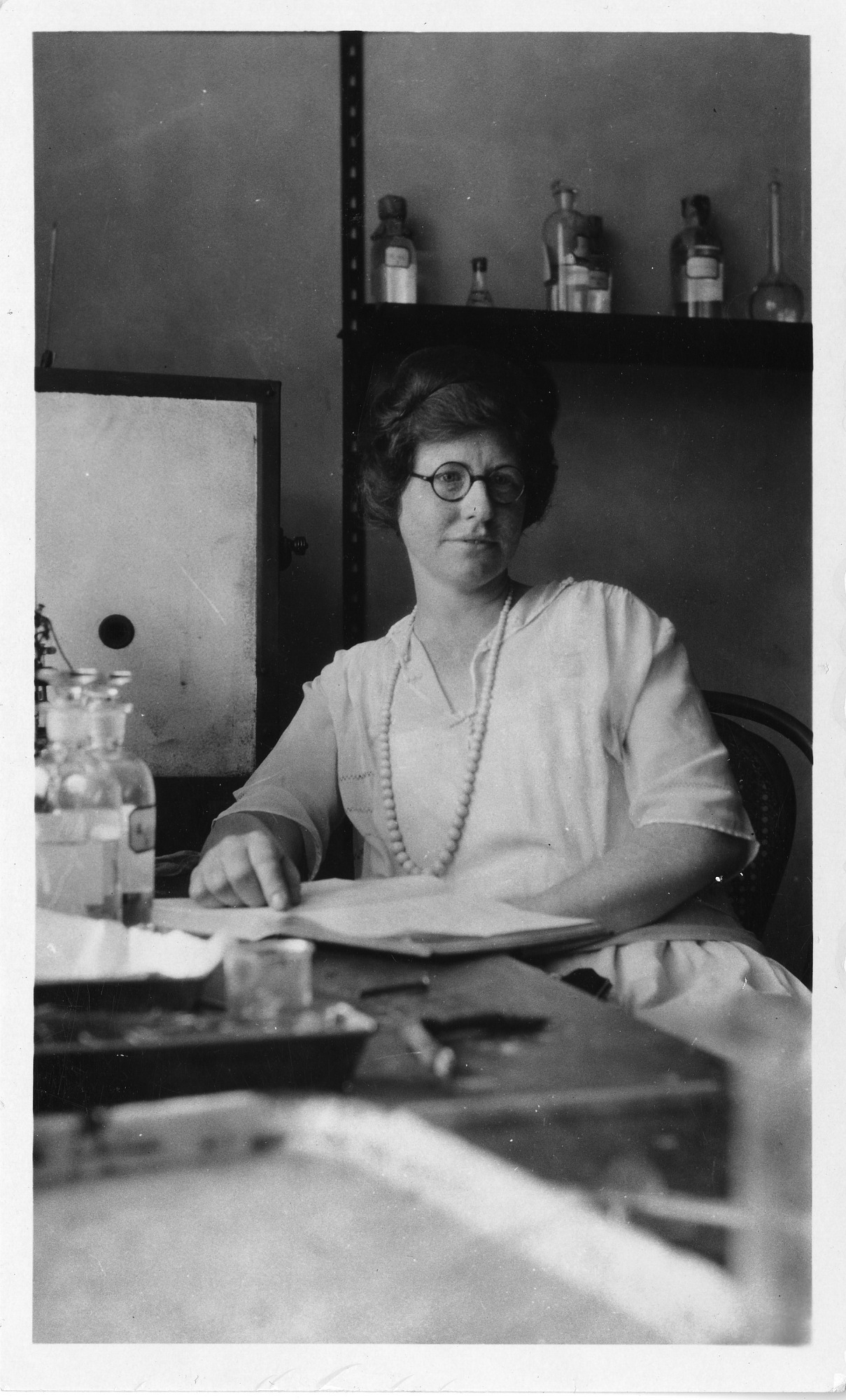 Elizabeth M. Bright, sitting in lab