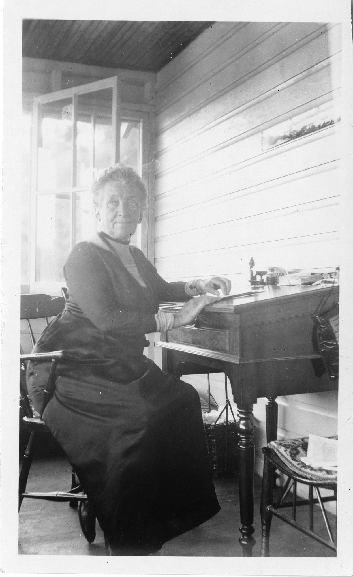 Cornelia Maria Clapp (1849-1934), sitting at desk