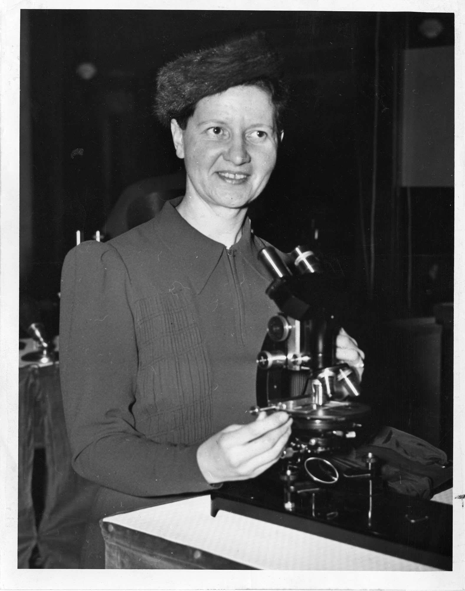 Wanda Margarite Kirkbride Farr (1895-1983), sitting in lab with microscope