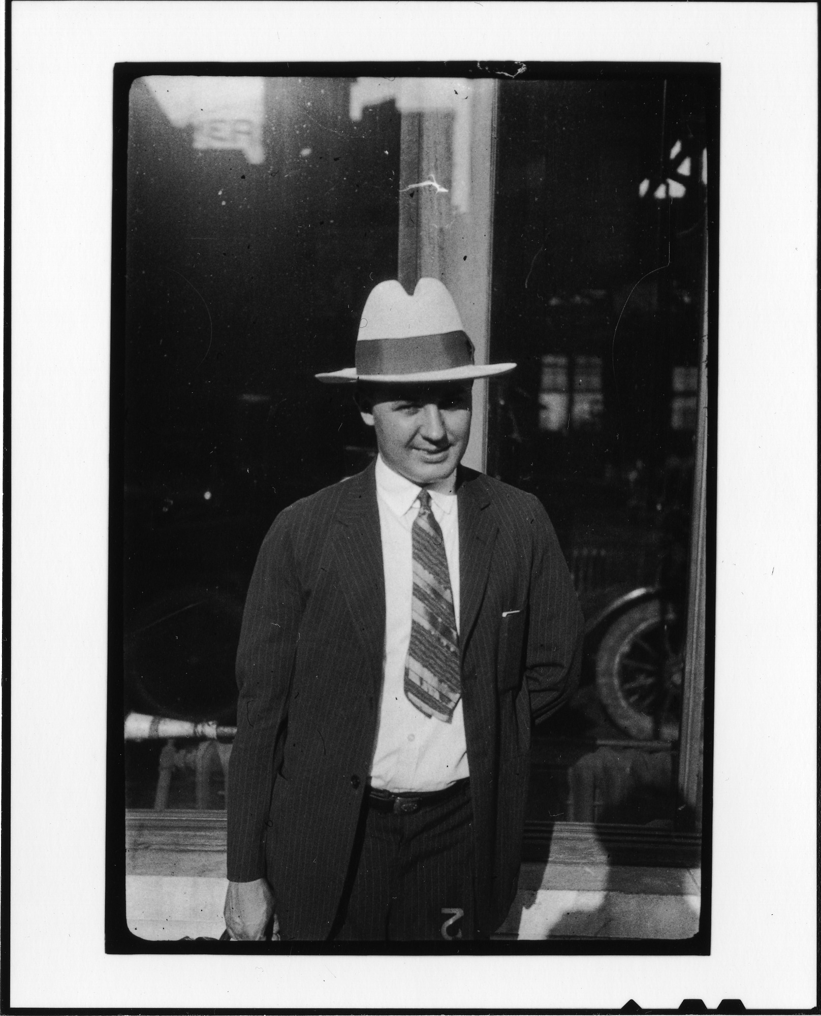 Tennessee v. John T. Scopes Trial: Unidentified man in front of auto dealership, Dayton, Tennessee