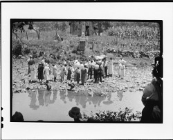 Worshipers observing a baptism near Dayton, Tennessee