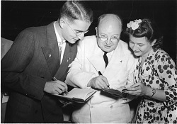 Paul E. Teschan (1923- ), Watson Davis (1896-1967), and Marina Prajmovsky (1924-1974), 1942