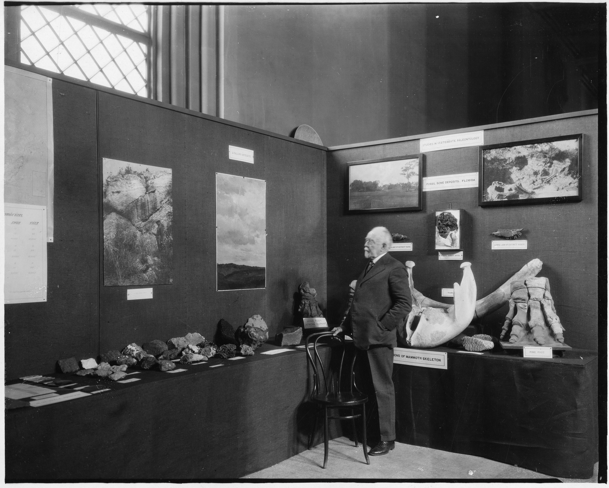 George P. Merrill Looking at Physical and Chemical Geology Exhibit