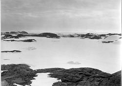 Landscape of Antarctica with Dark Rocks